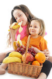Happy little girls with basket of fruits Royalty Free Stock Photography
