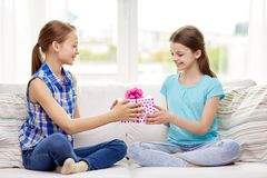 Happy little girls with birthday present at home Royalty Free Stock Photo