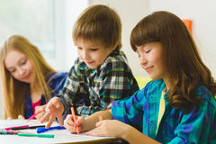 Happy Little girls and boy drawing pictures. Indoor at room Royalty Free Stock Image