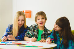 Happy Little girls and boy drawing pictures. Indoor at room Royalty Free Stock Photos