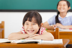 Happy little girls in the classroom Stock Photography