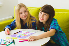 Happy Little girls drawing pictures. Indoor at room Royalty Free Stock Photography