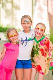 Happy little girls with face art paint in the park. Royalty Free Stock Photo