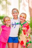 Happy little girls with face art paint in the park. royalty free stock photography
