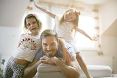 Happy little girls with father. royalty free stock images
