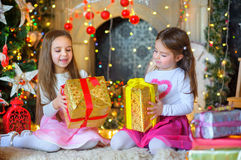 Happy little girls with a gift in hands. stock photo