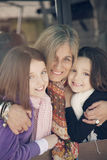 Happy little girls with grandmother Stock Image