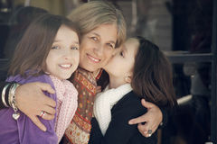 Happy little girls with grandmother Stock Photos