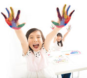 Happy little girls with hands in the paint Stock Images