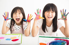 Happy little girls with hands in the paint Stock Image