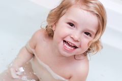 Happy little girls have in the bathroom. Brushing her teeth with a toothbrush royalty free stock photos