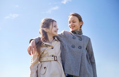 Happy little girls hugging and talking outdoors Royalty Free Stock Photography
