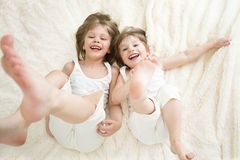 Happy little girls lying on back top view Stock Images