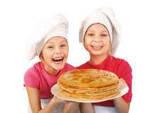 Happy little girls with pancakes Stock Photos