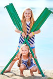 Happy little girls play with paddle at beach Royalty Free Stock Images