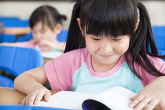 Happy little girls study Stock Photos