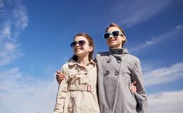 Happy little girls in sunglasses hugging outdoors Stock Photo