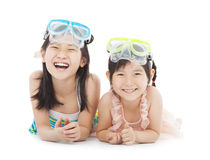 Happy little girls with swimsuit isolated on white. Over white royalty free stock photography