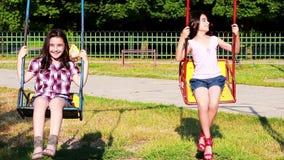 Happy little girls swinging Royalty Free Stock Photos