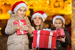 Happy little girls and their mummy with presents Royalty Free Stock Photography