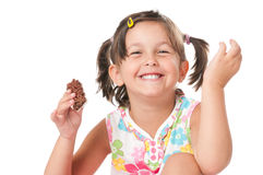 Happy little have a snack. Happy joyful little girl eating chocolate bar for snack isolated on white background stock images