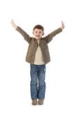 Happy little kid with arms wide open. Happy little kid standing with arms wide open, smiling happily Royalty Free Stock Photos