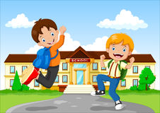 Happy little kid with backpack on school building backgrond Stock Photography