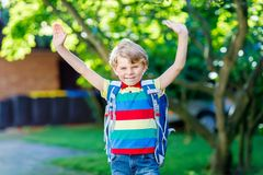 Little kid boy with school satchel on first day to school Stock Photography