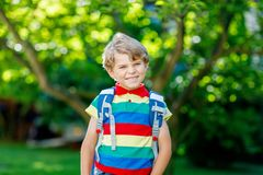 Little kid boy with school satchel on first day to school Stock Photo