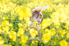 Happy little kid boy with Easter bunny ears, celebrating Easter Stock Image