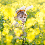 Happy little kid boy with Easter bunny ears, celebrating Easter Stock Photos