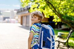 Little kid boy with school satchel on first day to school. Happy little kid boy with glasses and backpack or satchel on his first day to school or nursery. Child Royalty Free Stock Photo