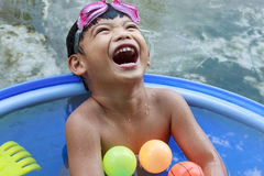 Happy little kid boy having fun in bathtub Stock Photo