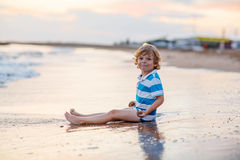 Happy little kid boy having fun with sand castle Stock Photography