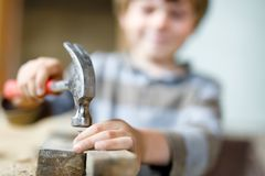 Little kid boy helping with toy tools on construciton site. Happy little kid boy helping with toy tools on construction site. Funny child of 7 years having fun Stock Images