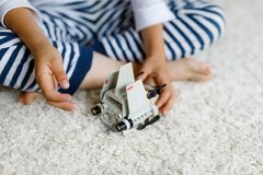 Happy little kid boy playing with space shuttle toy. Cute child in having fun in the morning before school. Closeup stock photography