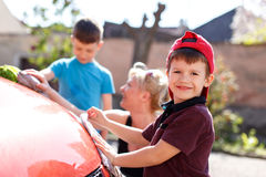 Happy little kid car wash with family Royalty Free Stock Image