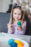 A happy little kid coloring easter eggs Royalty Free Stock Photo
