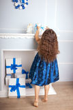 Happy little kid decorate the Christmas tree and home. Royalty Free Stock Photo