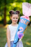 Happy little kid girl with backpack or satchel and big school bag or cone traditional in Germany for the first day of. School. Healthy adorable child outdoors royalty free stock image