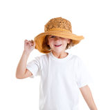 Happy little kid girl with summer hat isolated. On white stock photography