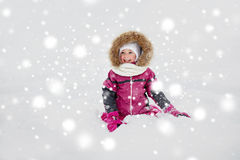 Happy little kid or girl in winter clothes on snow Royalty Free Stock Photo