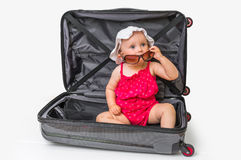 Happy little kid inside suitcase isolated on white stock images
