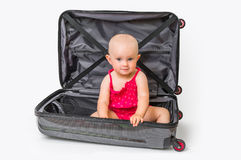 Happy little kid inside suitcase isolated on white stock photography