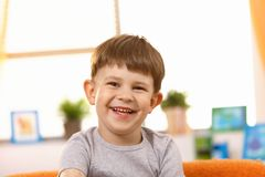 Happy little kid laughing Stock Image