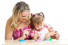 Happy little kid and mother play together Stock Image