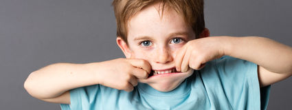Happy little kid playing with his mouth for silly childhood Royalty Free Stock Photography