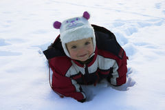 Happy little kid playing in snow Stock Photography