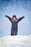 Happy little kid is playing in snow Royalty Free Stock Photos
