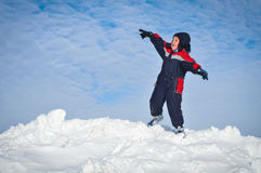 Happy little kid is playing in snow Royalty Free Stock Image